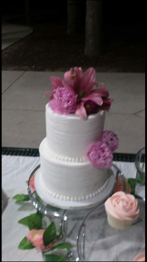 rustic cake with fresh flowers and matching rose cupcakes