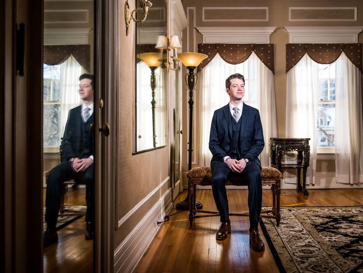 Groom posing in elegant room