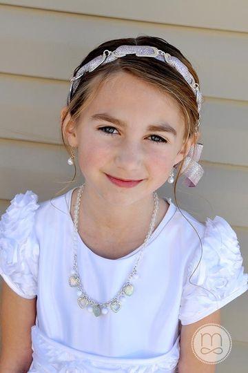 This sweet girl is wearing the VersaStyle piece Spun Sugar ($55.00)  Weave a beautiful ribbon...
