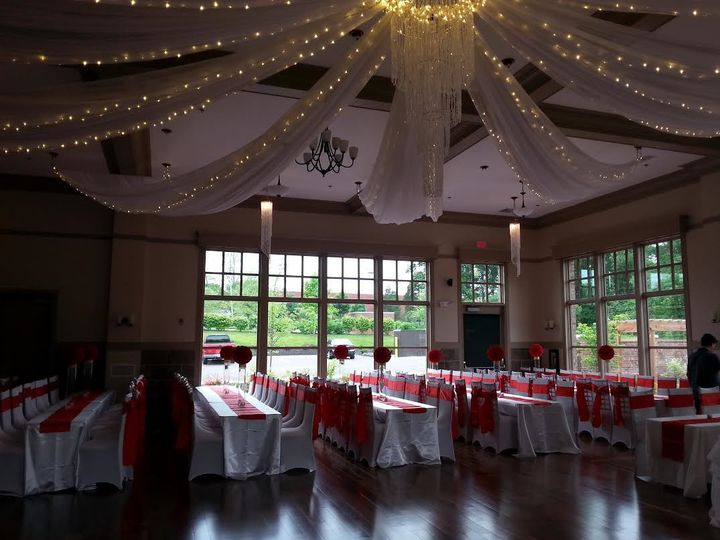 chairs and red tables under lighted draped ceiling