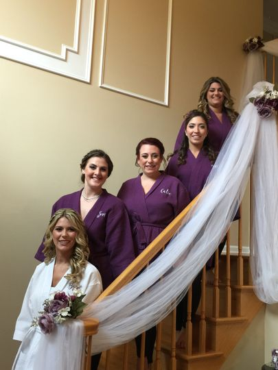 Bride and her bridesmaids in their robes