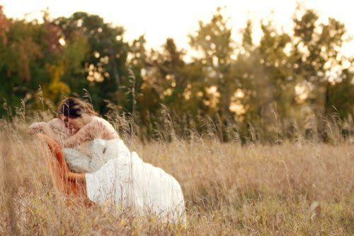 Bride and Groom Private Moment in Field with Chair