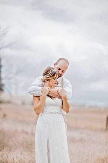 Hugging his bride