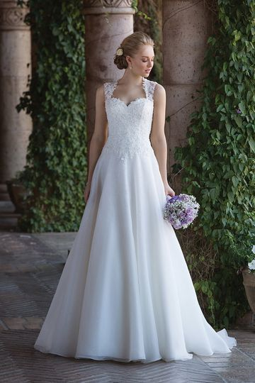 Sincerity Bridal4009Cinderella styling on this Queen Anne organza A-line. Embroidered lace...