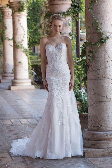 Sincerity Bridal4016Satin is far from traditional when styled with this tulle overlay....