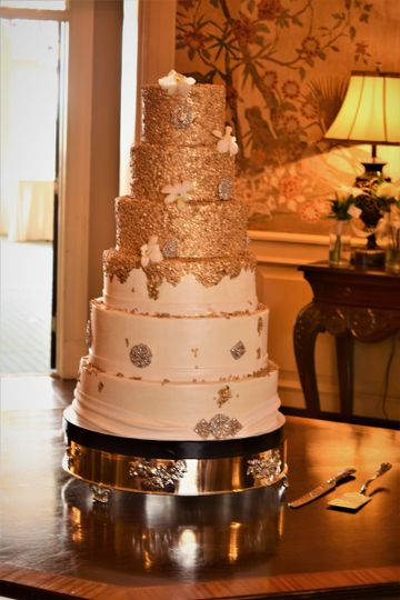 Tall wedding cake with gold bits