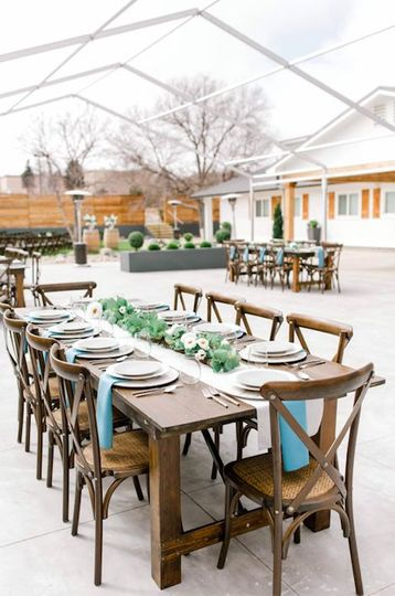 Our beautiful, wood farmhouse tables and crossback chairs are standard for you and all your guests...