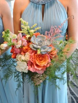 Vibrant colors reflect the sunset in this bridesmaid's bouquet.