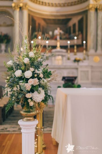 Soft colors in a gold urn flank the altar at the beautiful St. Cecilia's Parish in Boston.