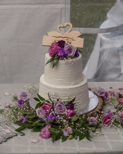 Cake flower accents in shades of Purple and Lavender, to include roses, carnation babys breath and...
