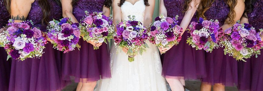 Purple and lavender bouquets, using roses, hydrangea, carnations and calla lillys.Photography...