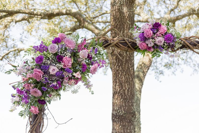 Spring floral arch in shades of Purple and Lavender, to include roses, carnation, stock, babys...