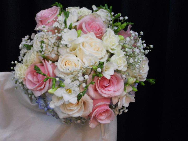 Ceremony arrangement using light pink and white rose, white hydrangea, babys breath