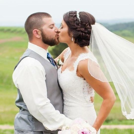 Newlyweds kiss | Photo by Limefish Studio Photography