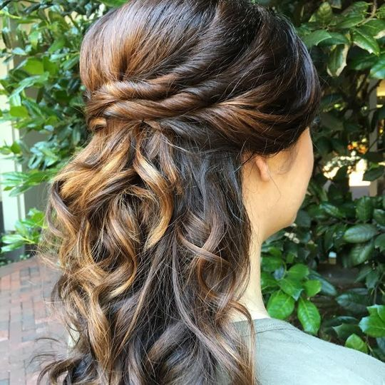 Curly half pinned back