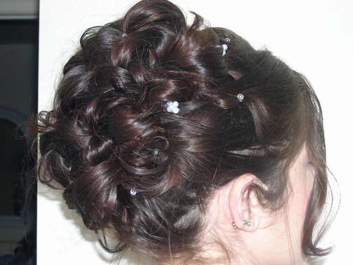 Intricate updo with hair pieces