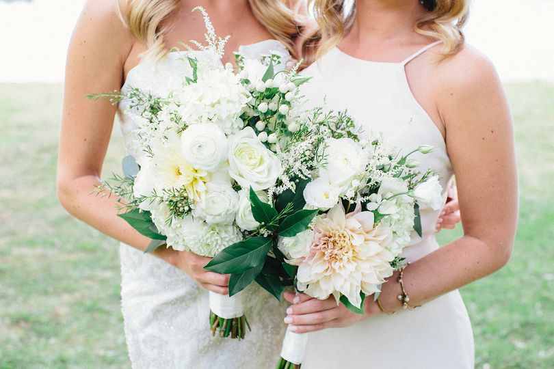 A bride and her maid-of-honor bouquets exclusively by planned perfectly hv