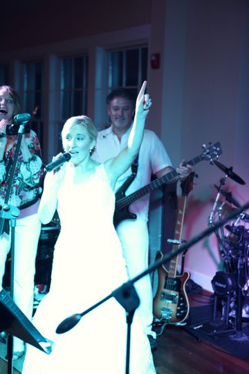 Bride sings with band. Photo provided by Dana Laymon Photography.