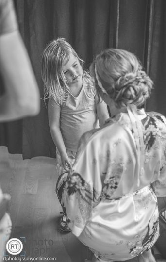 Bride talking to a little girl
