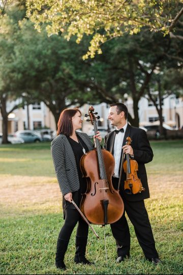 Cellist and violinist sharing laughs