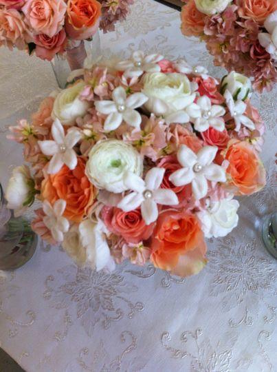 White and orange floral centerpiece