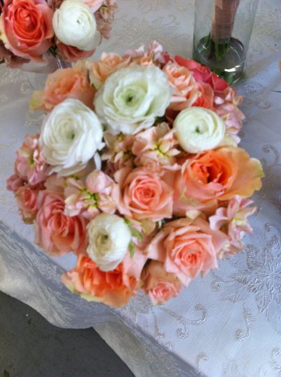 White roses with coral flowers