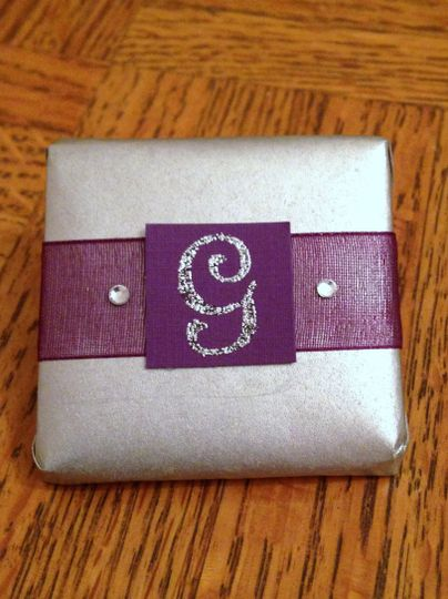 One of our many monogram initials--shown in silver paper with purple organza ribbon, silver glitter...