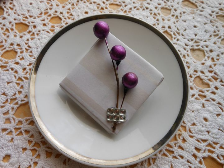 Here is a bit of Avant garde with a stripe white paper and rustic purple balls and rhinestone trio...