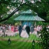 bride walking w parents
