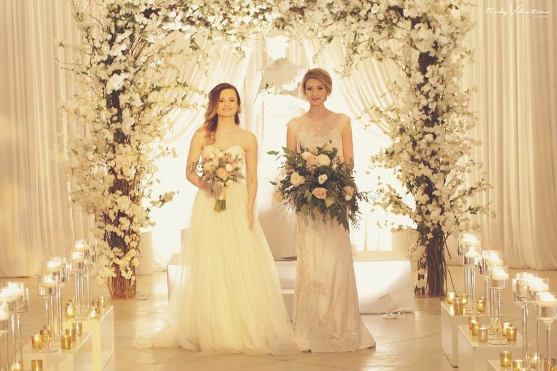 1st floor ceremony room Ceremony .We love the beautiful flower arch created by Juliet Tan Floral...