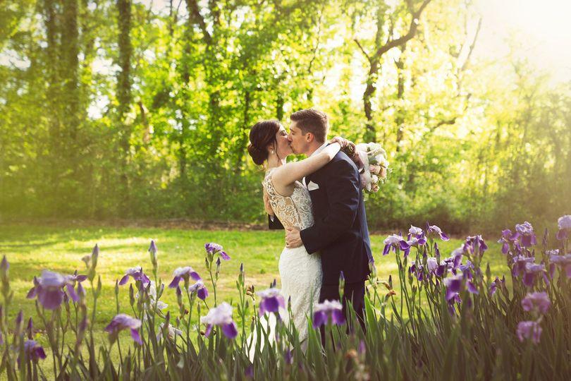 Couple kissing in a garden