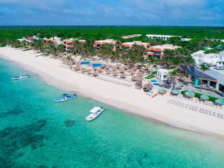 White sand beachfront with a coral reef