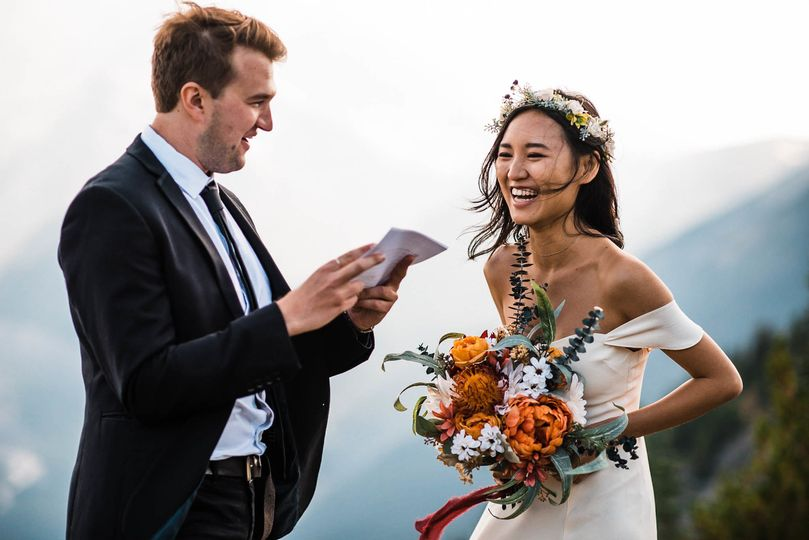 Reading letters from their family during their intimate elopement in Mt. Rainier National Park.