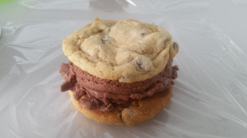 Homemade chipwich sandwich with chocolate ice cream.