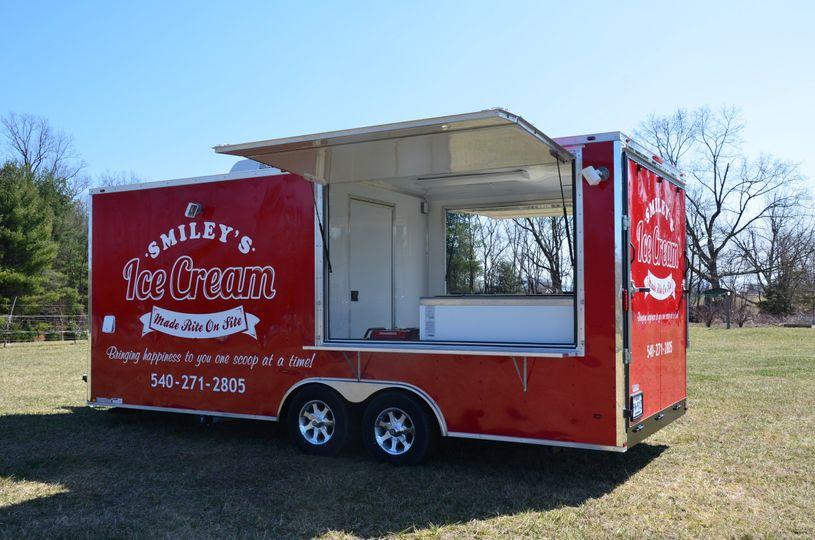 Ice cream trailer with sides opened for serving.