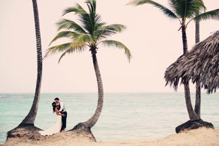 wedding on beach with palm trees