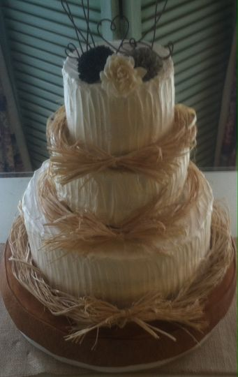 Country Style butter cream cake with raffia and paper flowers and wired monogram topper