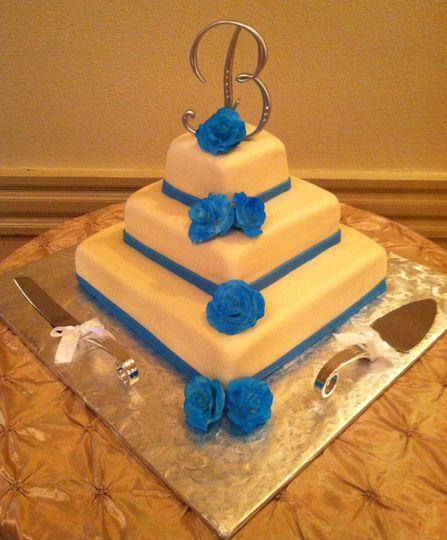 Malibu Blue and Champagne wedding cake with handmade sugar roses