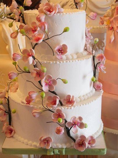 cookie wedding cake. 800x800 1281390188216 bridalshow2010031; 1281390249205 callalillycascade02 cookie wedding cake