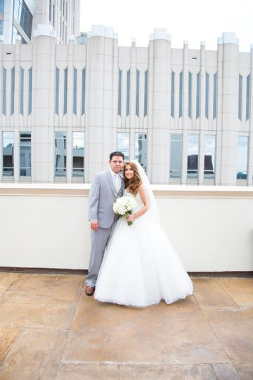 bride and groom with building