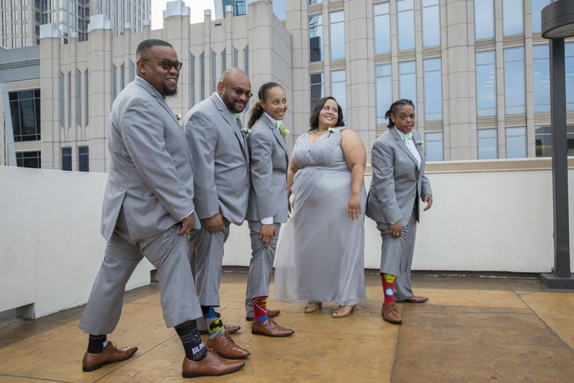 bride with groomsmen and socks