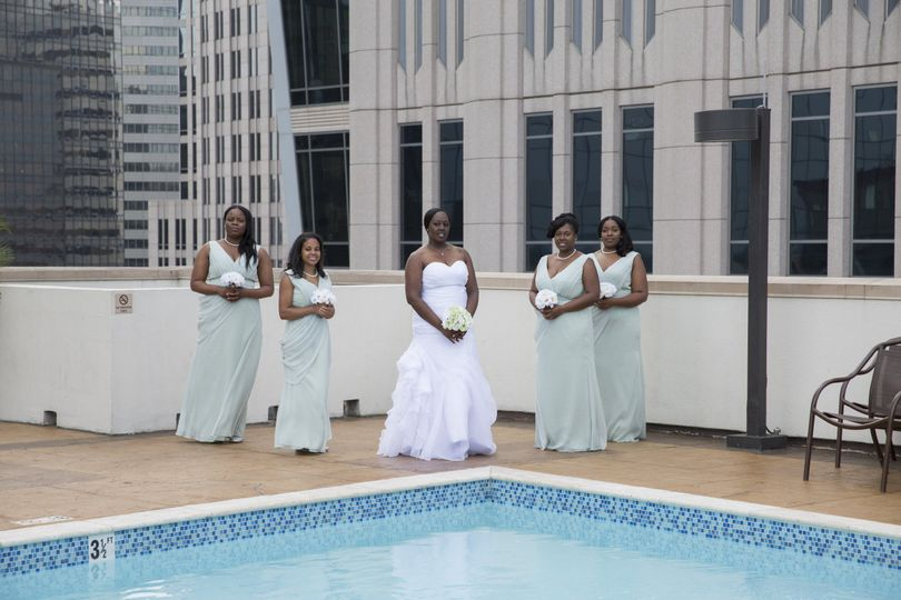 bride with bridesmaids by the pool close up