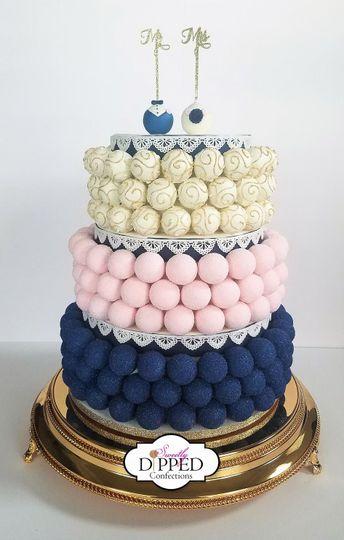 Blush, navy, white, and gold cake pop cake