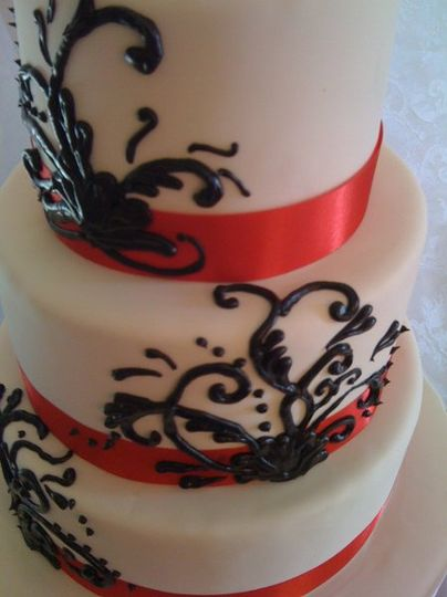 Black Swirls with Red Ribbon on this fondant cake.