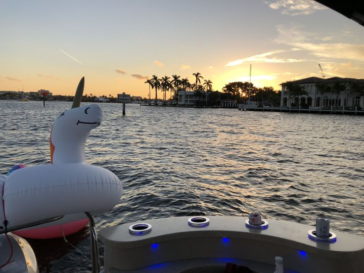 Always a great sunset from the water. The blue lights just add to it!