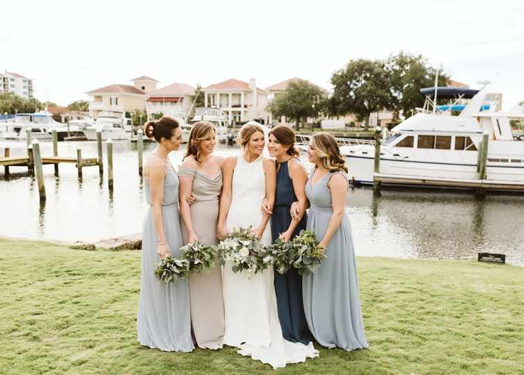 Bride and her bridesmaids by the docks