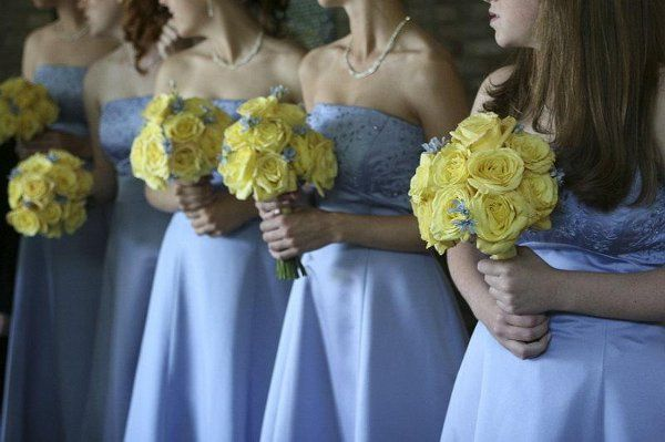 June wedding w/blue dresses & yellow roses with blue accent flowers