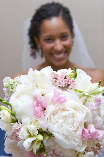 Bride with White peonies, freesia, pink sweet peas