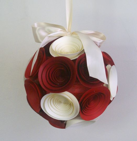 A medium pomander/kissing ball in reds and ivory.