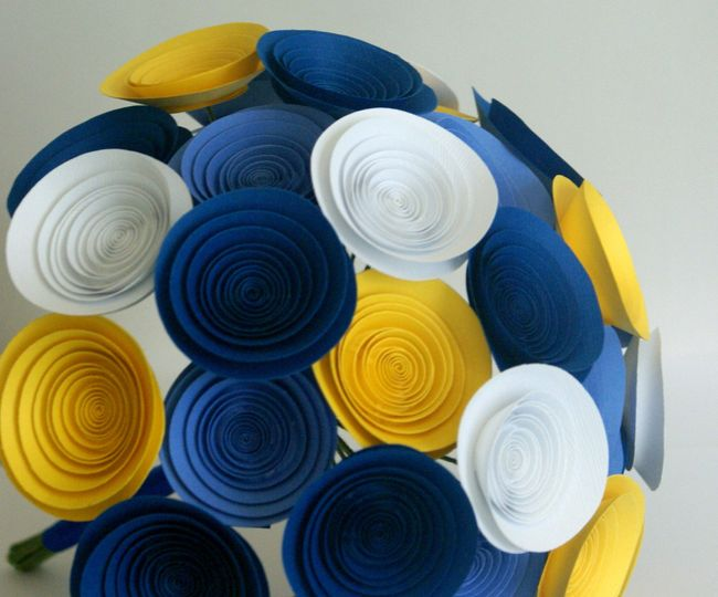 A large wildflower bouquet in royal blue, cornflower, white, and sun yellow.